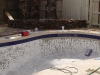 A pool chipped out with new tile installed